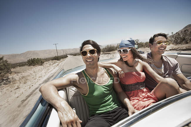Friends in car on the open road — Stock Photo