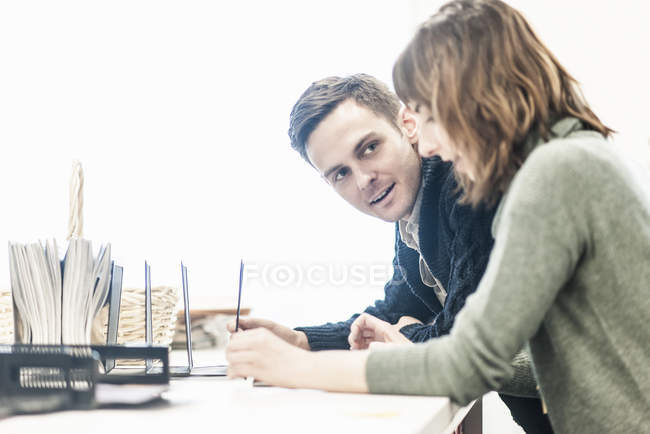 Man and a woman seated side by side — Stock Photo