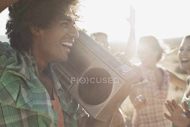 People on the open road with a boombox. — Stock Photo