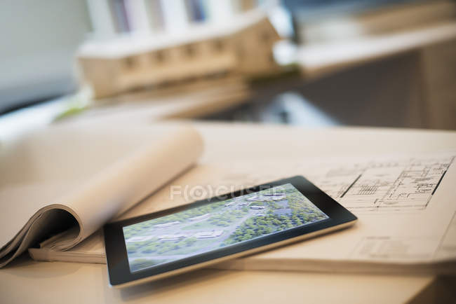 Architectural plans and a computer tablet. — Stock Photo