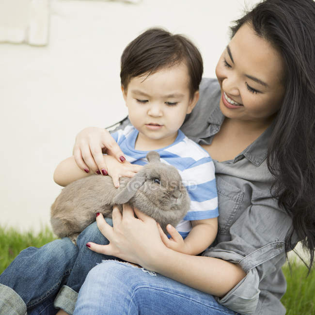 Woman holding a rabbit — Stock Photo