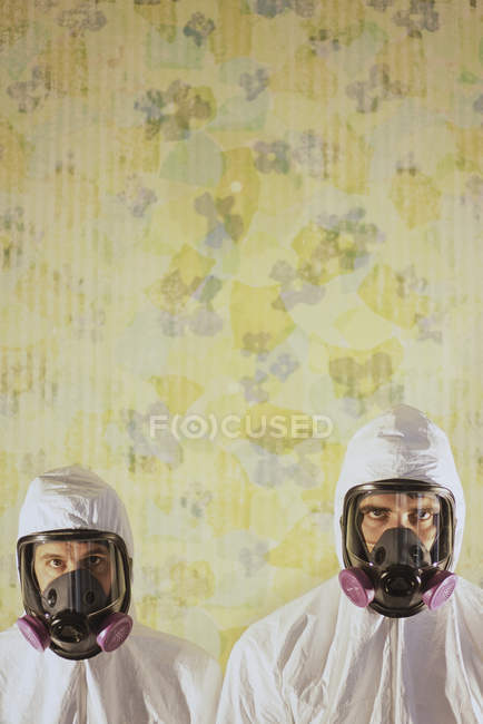 Men wearing protective hazmat — Stock Photo