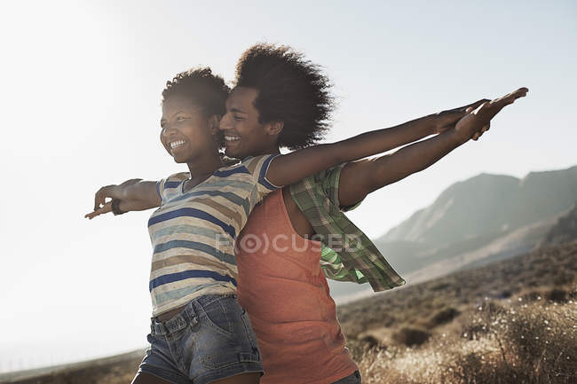 Couple together with arms outstretched — Stock Photo