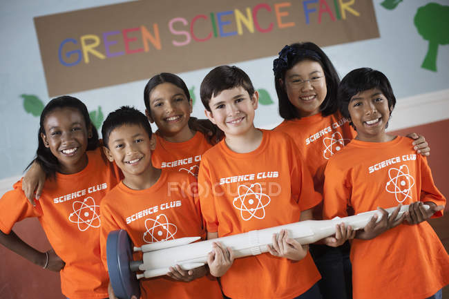 Students holding long rocket — Stock Photo