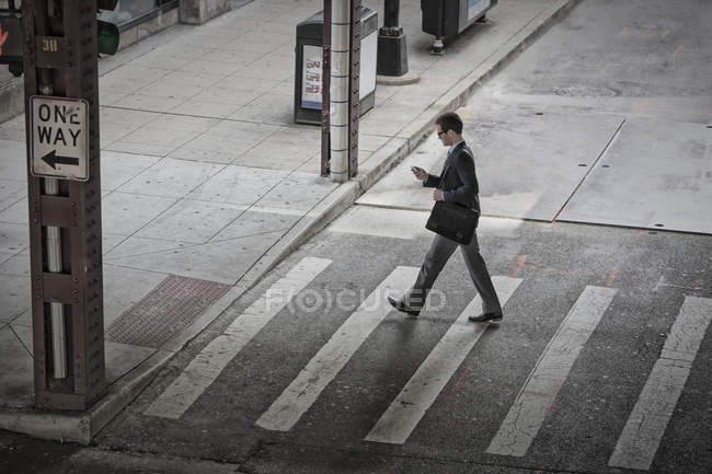 Man in middle of pedestrian road — Stock Photo