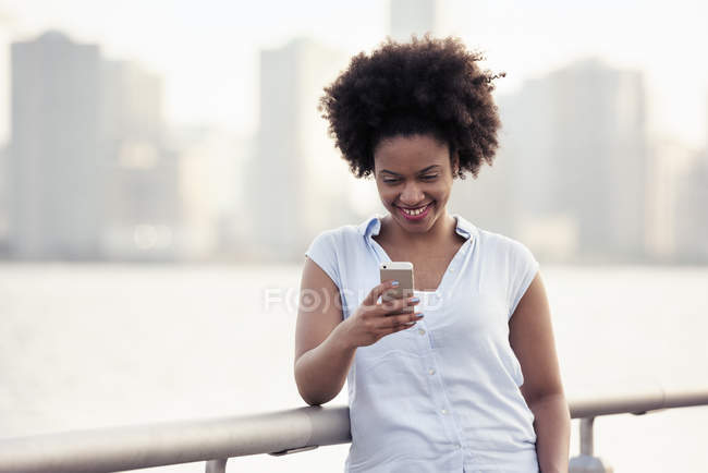 Woman checking her cell phone — Stock Photo