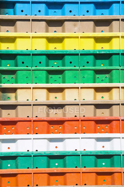 Stacks of multi-colored containers — Stock Photo