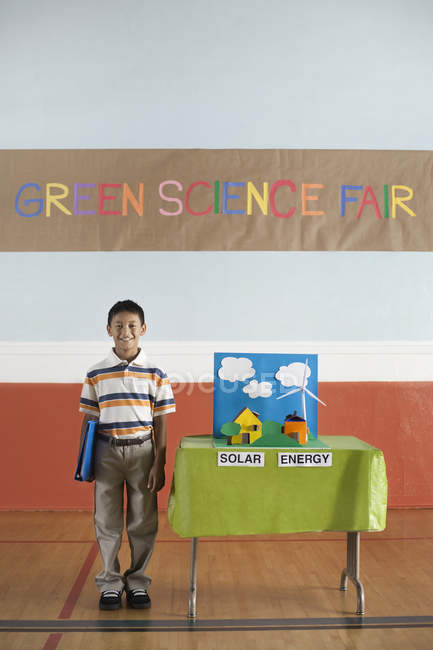 Boy under a Green Science Fair — Stock Photo
