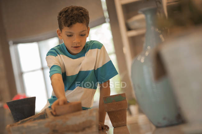 Boy planting out seedlings — Stock Photo