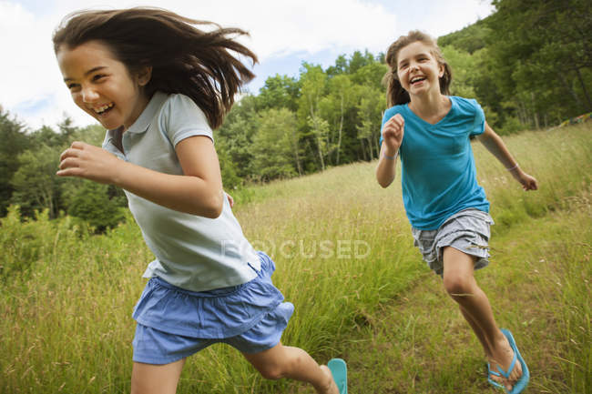 Girls running and playing chase — Stock Photo