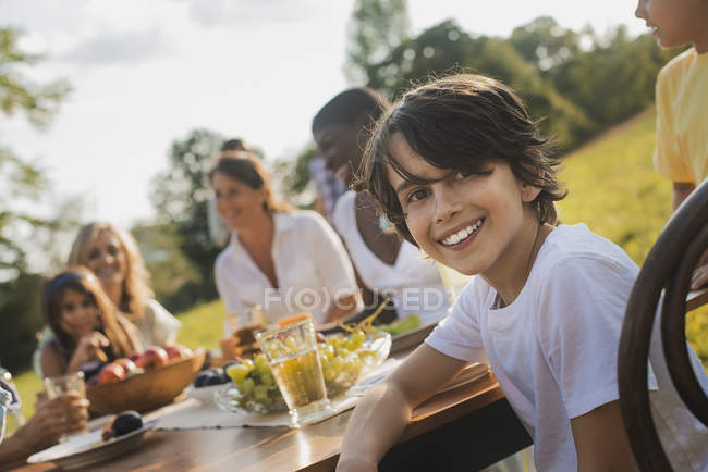 Picnic or buffet in the early evening. — Stock Photo