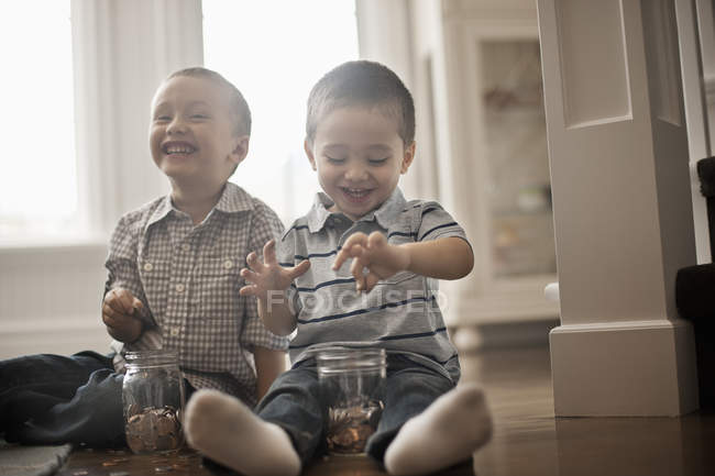 Children playing with coins — Stock Photo