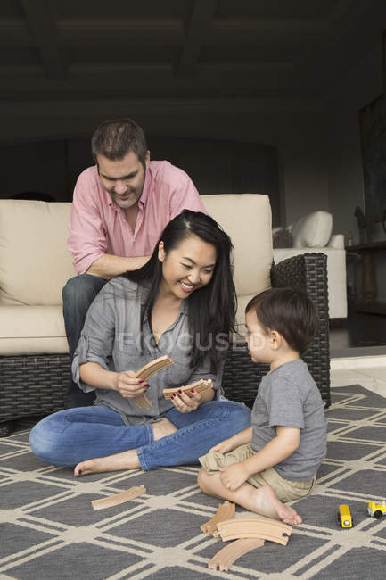 Man and woman playing with young son — Stock Photo