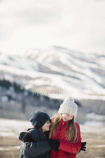 Brother and sister hugging and laughing — Stock Photo