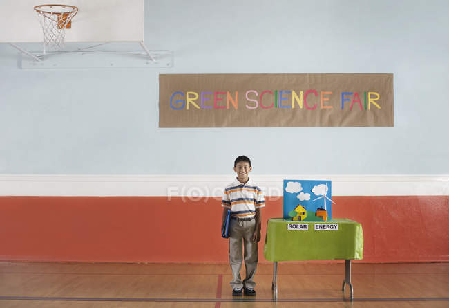 Boy at Green Science Fair sign — Stock Photo
