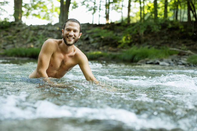 Young man swimming — Stock Photo