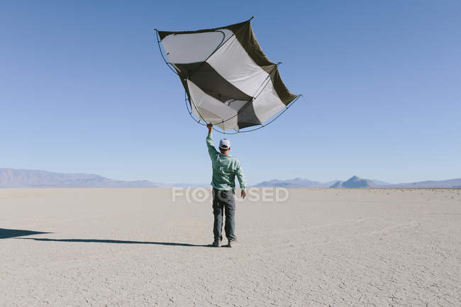 Man with capsule pod camping tent — Stock Photo