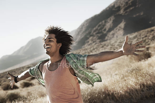 Man leaning into the breeze. — Stock Photo