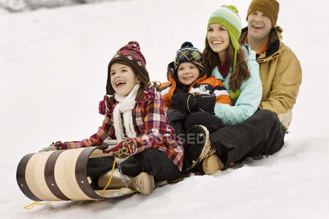 Children sitting on a sledge — Stock Photo