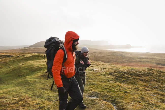 Men walking with backpacks — Stock Photo