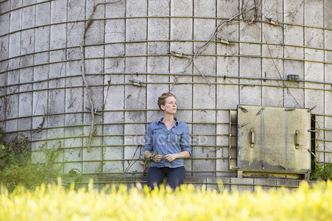 Woman taking a break near  silo — Stock Photo