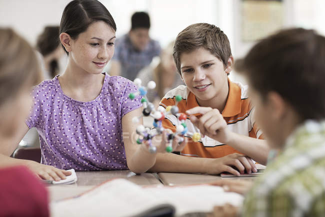 Students looking at a molecular structure — Stock Photo