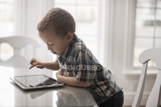 Young child using a digital tablet — Stock Photo