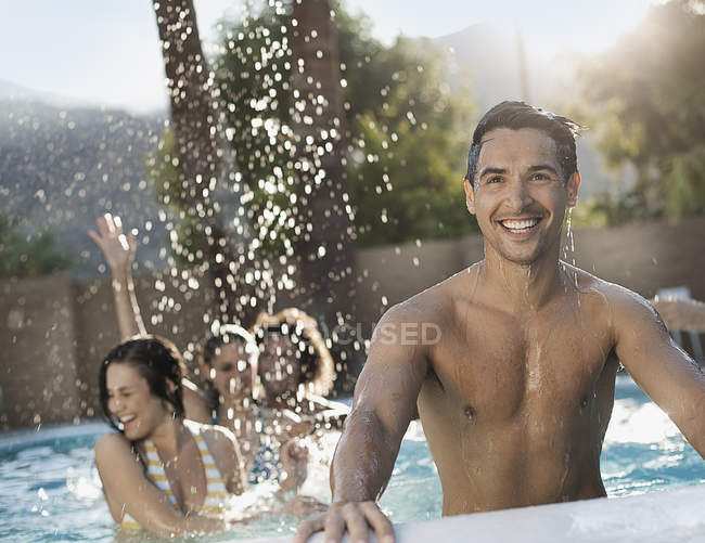 Men and women in the swimming pool — Stock Photo