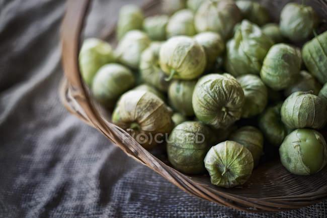 Organic Tomatillos in basket — Stock Photo
