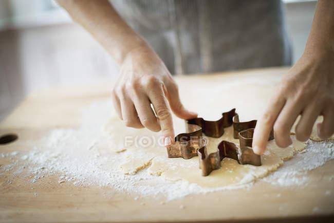 Woman making organic Christmas cookies — Stock Photo