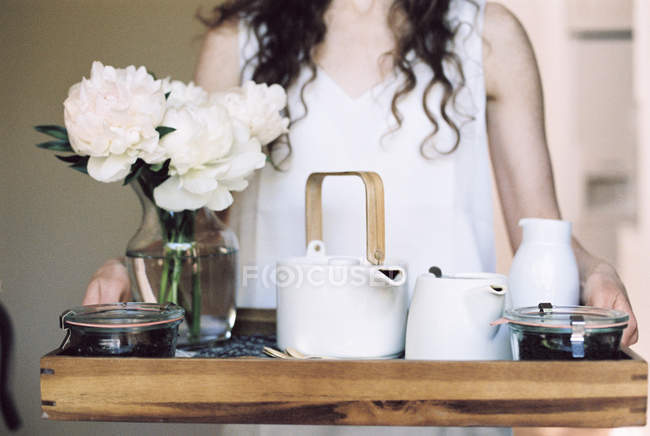 Woman carrying a tray — Stock Photo