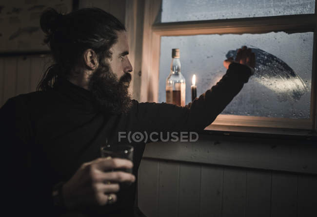 Man with a bottle of whisky — Stock Photo