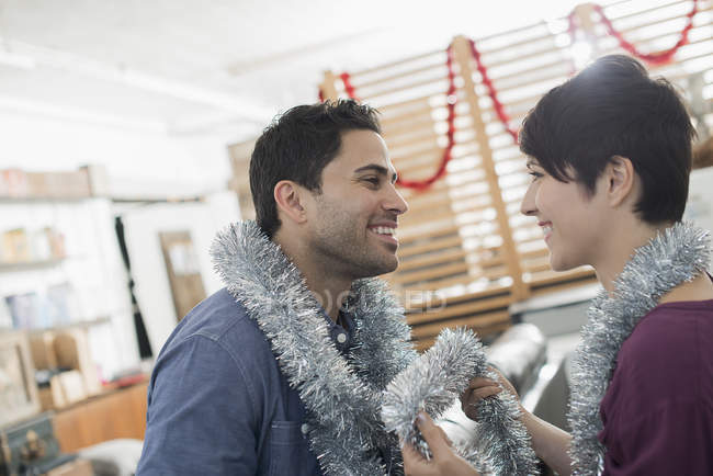 Man and woman with christmas decorations — Stock Photo