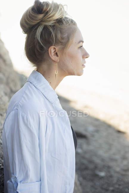 Blond woman with a hair bun. — Stock Photo