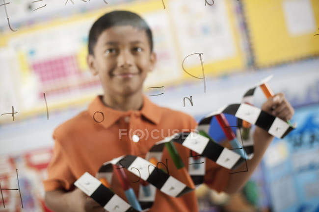 Boy holding a molecular structure model — Stock Photo