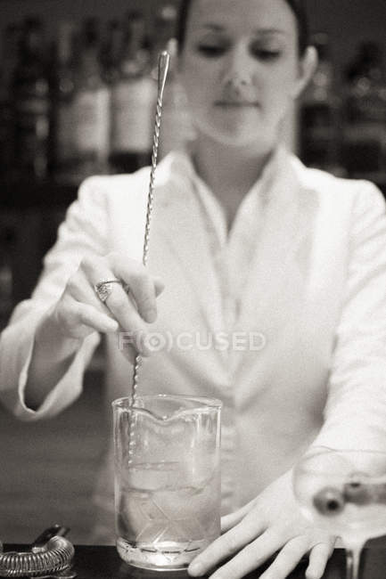 Woman mixing a cocktail — Stock Photo