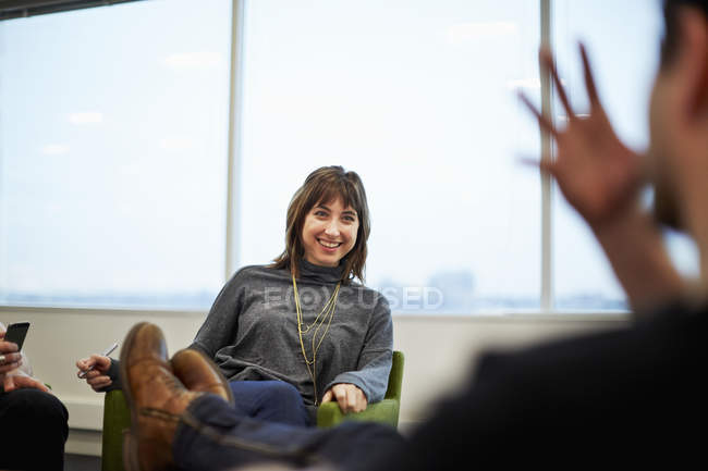 Woman seated in an office — Stock Photo