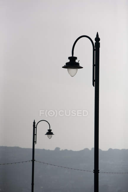 Two arched street lamps — Stock Photo