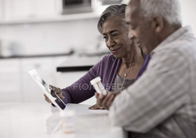 Senior couple using a digital tablet — Stock Photo