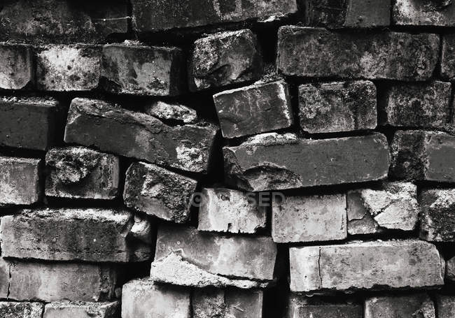 Pile of bricks with cracked edges — Stock Photo