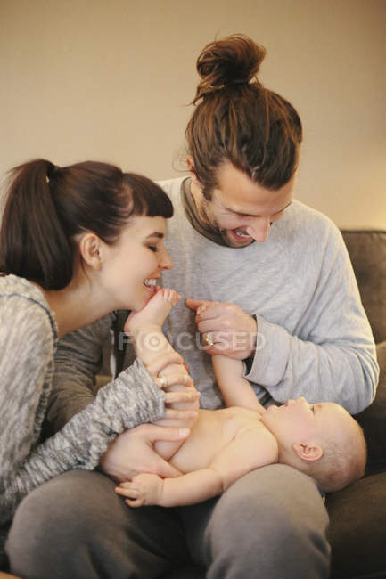 Parents with their small baby — Stock Photo
