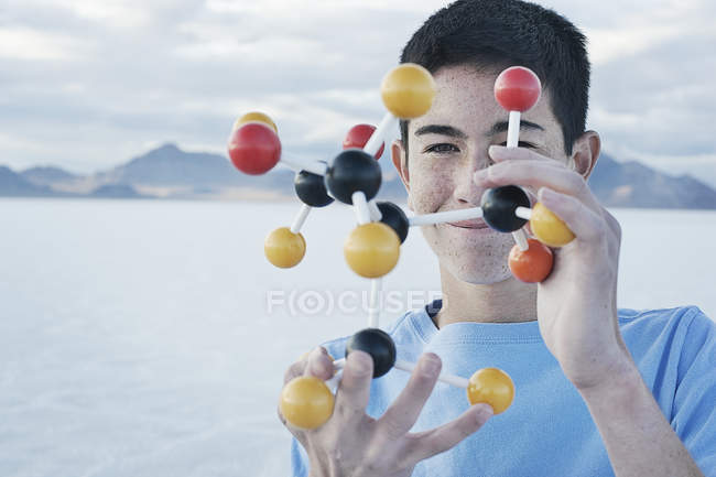 Teenage boy holding a molecular structure — Stock Photo