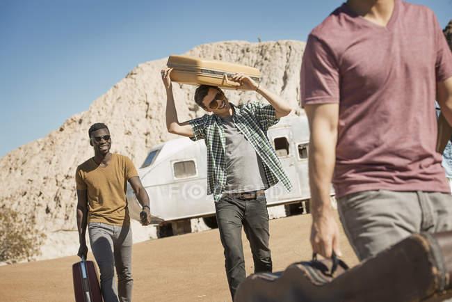 People walking in open desert country — Stock Photo