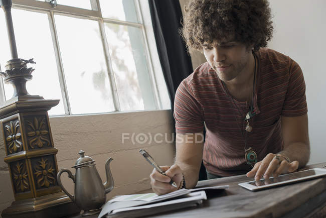 Man seated by  window — Stock Photo