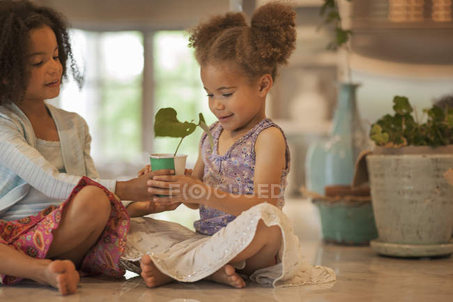 Girls sitting on a tabletop — Stock Photo