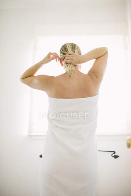 Woman in white towel in a bathroom — Stock Photo