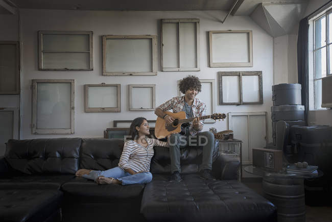 Man and woman sitting on a sofa. — Stock Photo