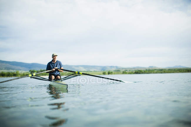 Man in a rowing boat — Stock Photo