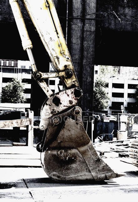 Backhoe shovel at a building site — Stock Photo