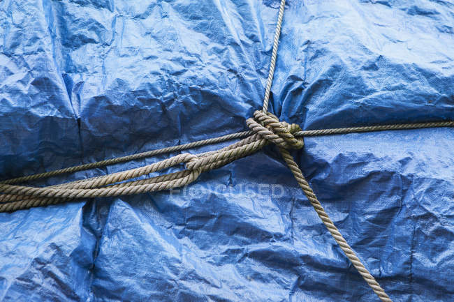 Blue tarpaulin covering — Stock Photo